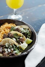 Lengua tacos from Tacos Tumbras are photographed for the Dining Out Guide.