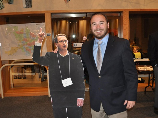 Josh Arritola, right, with a cardboard cutout of opponent Matt Shea.