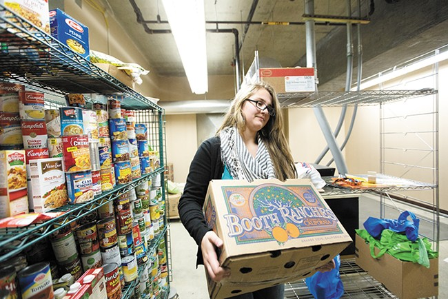 Lewis and Clark High School senior Danielle Aranda works at the school's Tiger Food Pantry for course credit. - YOUNG KWAK