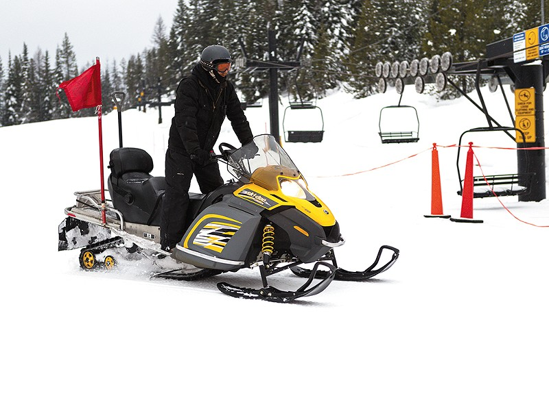 Lift Supervisor Stephen Jones snowmobiles to Lift No.4  for an inspection.