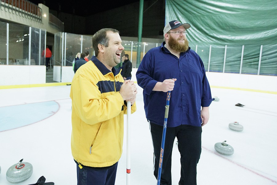 Lilac City Curling Club Treasurer Tony Murray, left, and Vice President Sam Normington share a laugh. - YOUNG KWAK