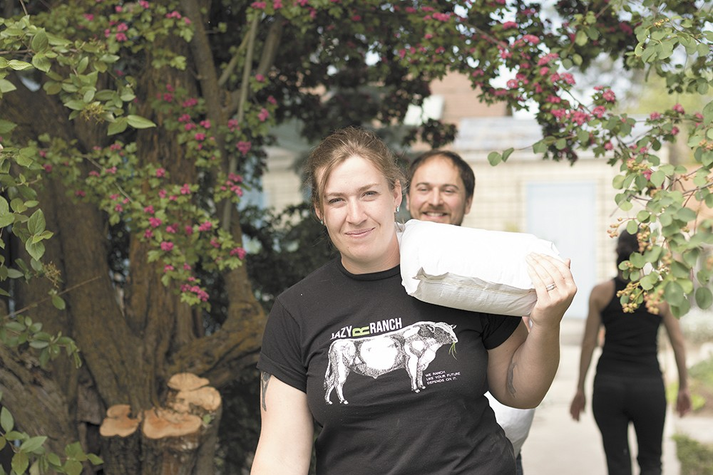 LINC's Beth Robinette and Joel Williamson make a delivery of lentils to Luna, on Spokane's South Hill. - YOUNG KWAK