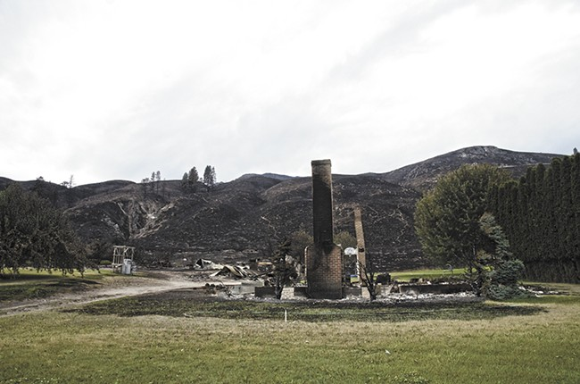 Little remains of the McGaha home along Old Highway 97 after the Carlton Complex Fire swept through earlier this month. - JACOB JONES
