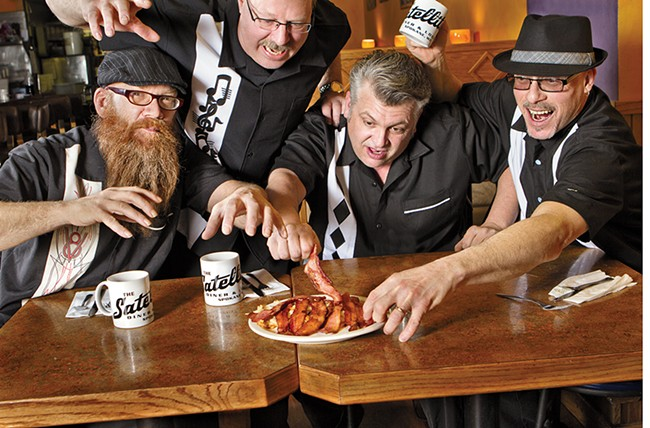 Local blues act Bakin' Phat (from left: Pat Potter, Ken Danielson, Dennis Higgins and Dave Allen) fight over strips of bacon at Satellite Diner & Lounge. - CHAD RAMSEY