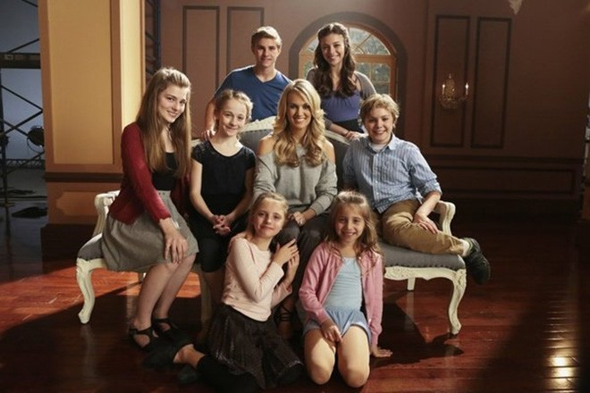 Sophia Caruso, seated second from the left in black, with Carrie Underwood and the other von Trapp children. - NBC