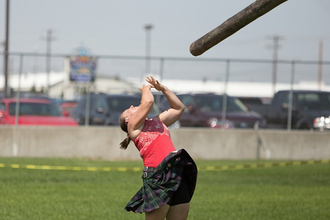 Maisie Walters, from Everett, Wash., tosses a caber during the women's amateur A & B competition. - YOUNG KWAK