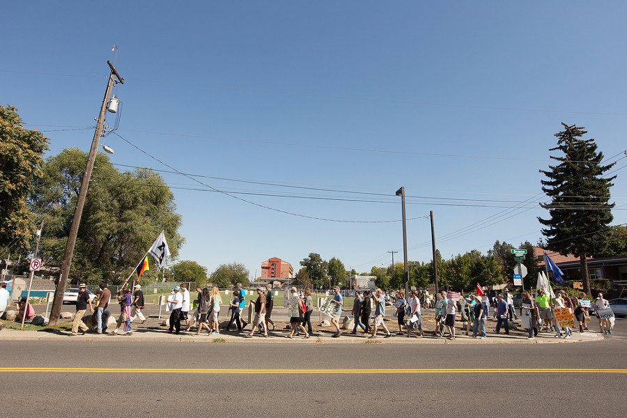 Marchers walk north on S. Browne St. - YOUNG KWAK