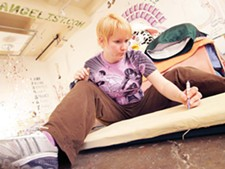 Marcia Dukes preps a painting on an ironing board during MONTH - YOUNG KWAK