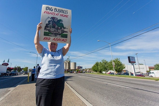 Marianne Torres protests against the threat of bombing Iraq. - MATT WEIGAND