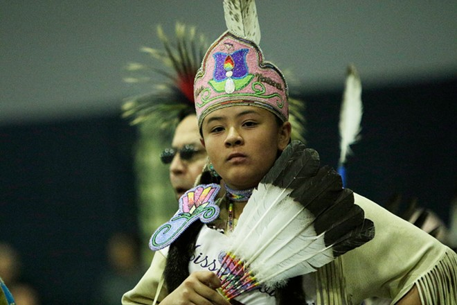 Marisa Shottanana-Ponce, of the Kootenai Tribe of Idaho, walks in the opening procession. - YOUNG KWAK