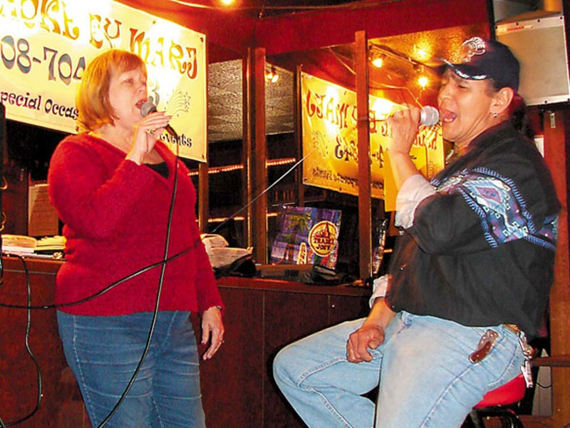 Marj Hopkins, left, has been hosting karaoke at the bar for nearly a decade.