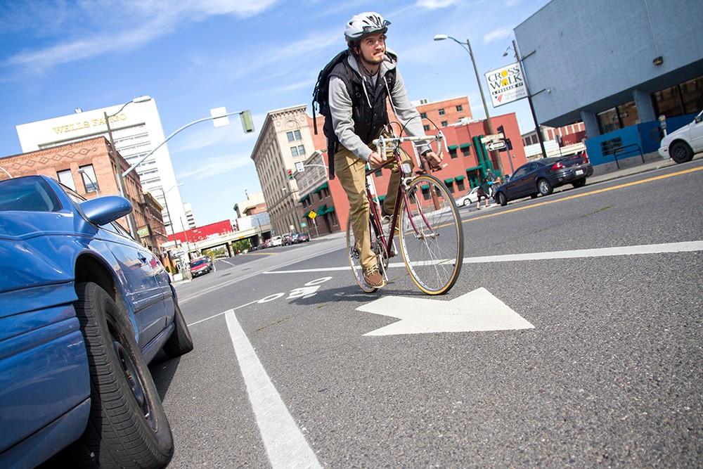 Mark Wilkins uses the bike lane on Howard and Second Avenue in downtown Spokane. - JENNIFER DEBARROS