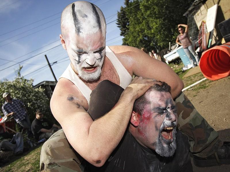 Master Mayhem puts King Chaos in a headlock. - YOUNG KWAK