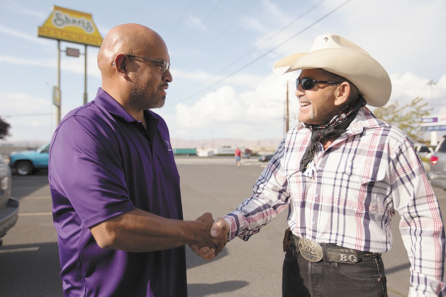 Mel Skahan, left, and Bob Gimlin greet each other outside Shari's restaurant in Union Gap. - YOUNG KWAK