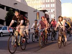 Members of the F---ing Bike Club ride through downtown Spokane - YOUNG KWAK