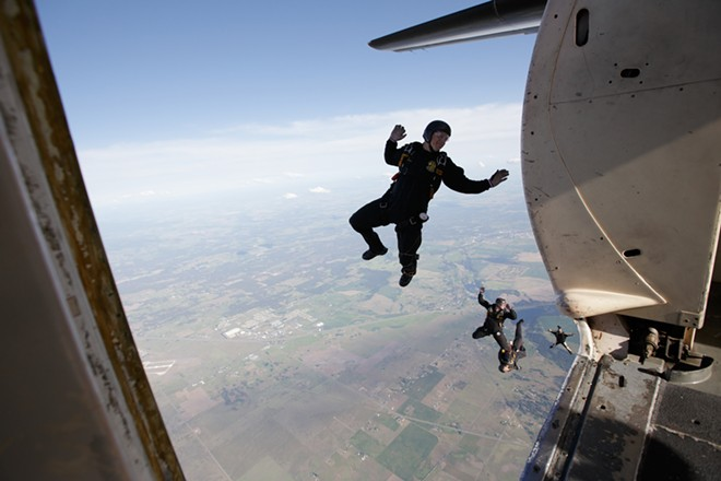 Members of the Golden Knights, the U.S. Army parachute team, leave their airplane during a practice jump. - YOUNG KWAK