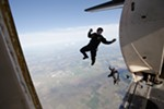 Members of the Golden Knights, the U.S. Army parachute team, leave their airplane during a practice jump.