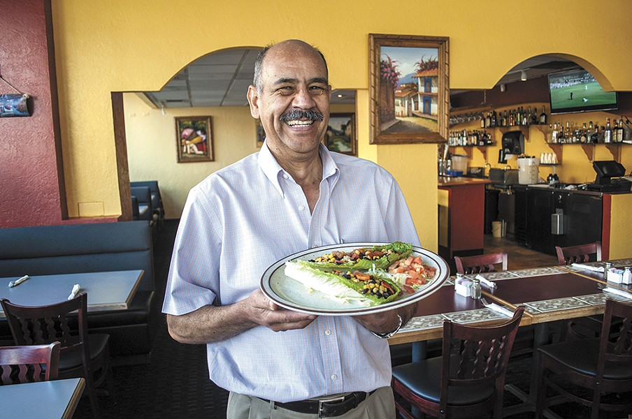 Mi Casa owner Luis Perez with his lettuce tacos. - SARAH WURTZ