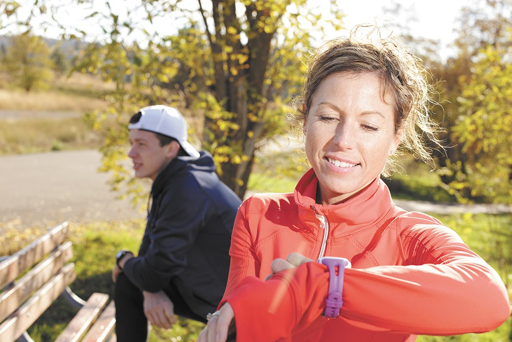 Michelle Neill, organizer of Bloomsday's Marmot March, uses fitness technology to juggle training and a busy life. - YOUNG KWAK