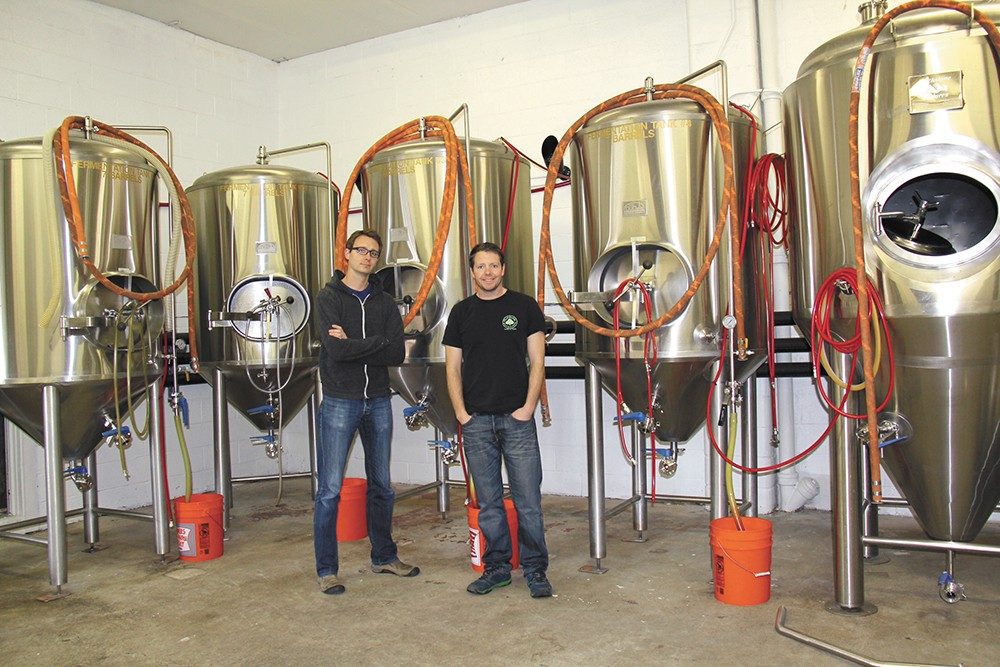 MickDuff's co-owners Mickey (left) and Duffy Mahoney with their new brewing equipment.