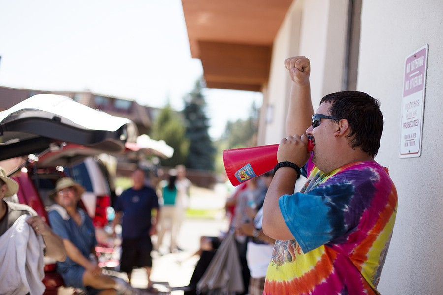 Mike Boyer, first in line, chants a pro-marijuana message through a megaphone as he waits for Spokane Green Leaf to open during the first day of legal Washington state recreational marijuana sales. Boyer starting waiting the previous day at 7:30 pm. - YOUNG KWAK