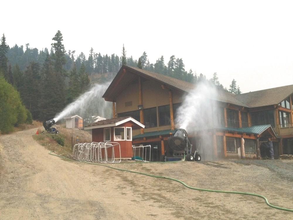 Mission Ridge staff trained their snowmaking guns on the lodge to keep it from burning. - JOSH JORGENSEN
