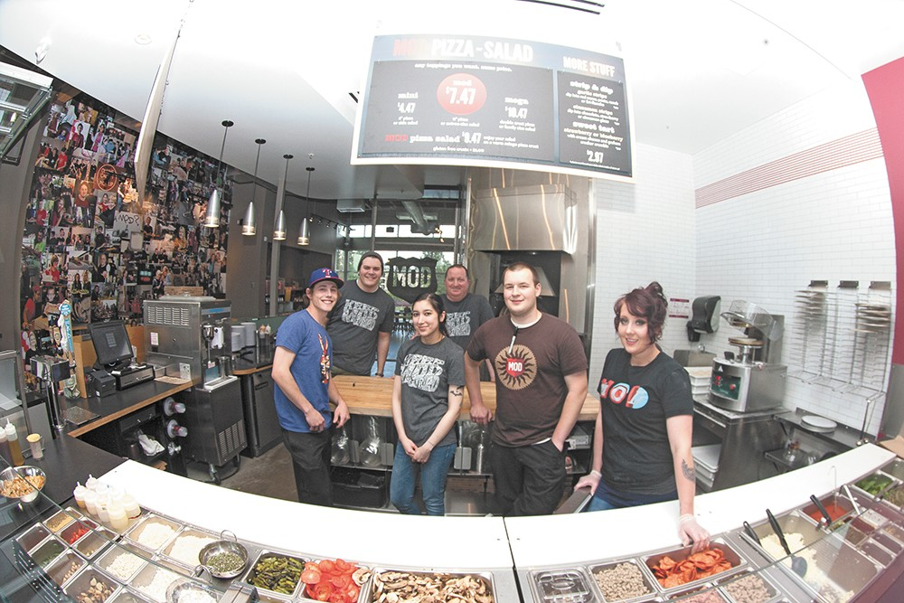 Mod Pizza general manager Michael Sherman (top center) with his employees at the new South Hill shop. - MEGHAN KIRK