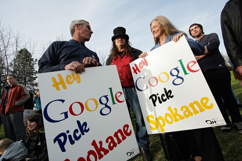 "(Left to right) Dale Burnham, Rick ""Harpman Hatter"" Bocook and Mayor Mary Verner speak during the ""Hey Google, Pick Spokane"" flash mob event at Riverfront Park in Spokane yesterday. An estimated 75 people attended. - YOUNG KWAK"