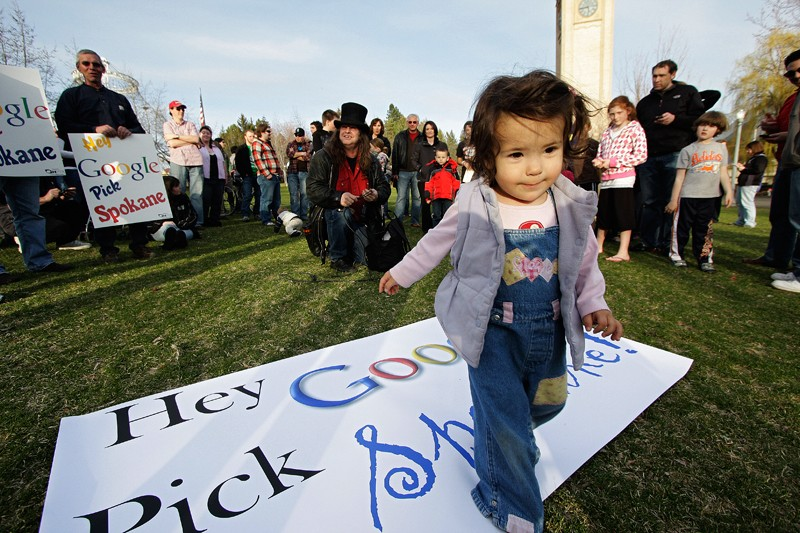 Fifteen-month-old Amelia Brunkan plays on a sign. - YOUNG KWAK