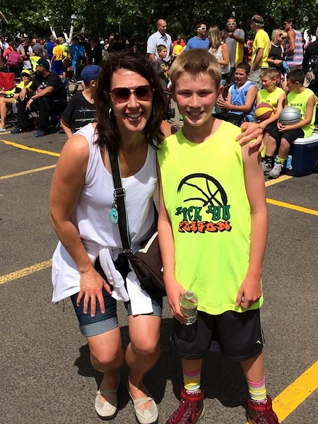 Kim Harlow showed son Camden Harlow her support while wearing one of Hoopfest's biggest trends, aviator sunglasses. - CONNOR HARLOW