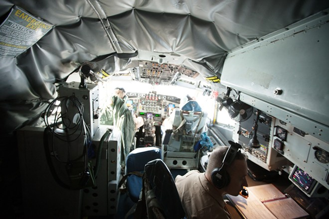 (Left to right) 376th Expeditionary Operations Group Pilot and Captain Alex Denton, Co-Pilot and Captain Mike Dobbs and Deputy Operations Group Commander and Navigator Lieutenant Colonel Gene Croft fly a KC-135. - YOUNG KWAK