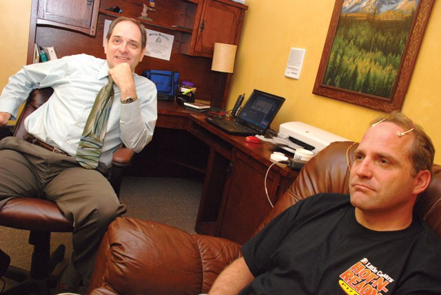 Myron Thurber (left) of Neurotherapy Northwest helps a patient modulate his brain waves. Results in treating anxiety and depression, Thurber says, can be remarkable. - TAMMY MARSHALL