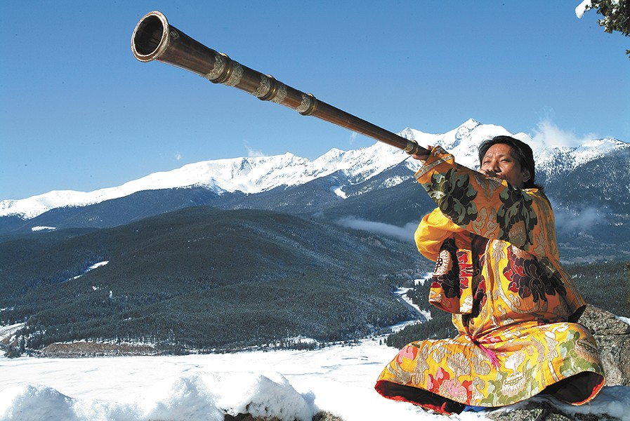 Nawang Khechog at peace in the mountains.
