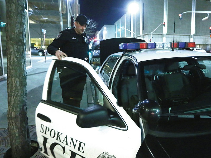 Neighborhood Conditions Officer Toby Bryer works the downtown Spokane area as part of a newly introduced community policing model. - YOUNG KWAK