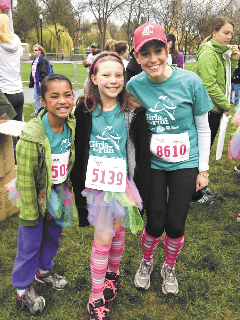 Neshyia and Sarah stop for a picture with their running buddy, Gale Bevington.