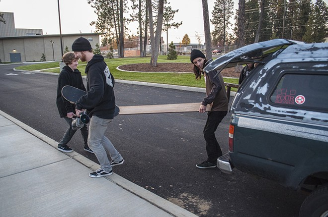 Visintainer, left, Ronnie Schroder, middle, and Marko, right, pack up their equipment after successfully landing tricks. - SARAH WURTZ