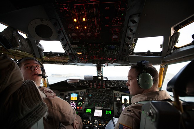 USAF Pilot Captain Joe D'Agostino, left, and Co-Pilot 1st Lieutenant Jacob Mueller conduct a pre-flight check on a KC-135 at Fairchild Air Force Base. - YOUNG KWAK