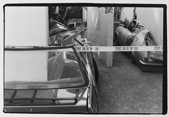 Cars crushed by an apartment building in aftermath of the Northridge earthquake, photographed Jan. 20, 1994. - YOUNG KWAK