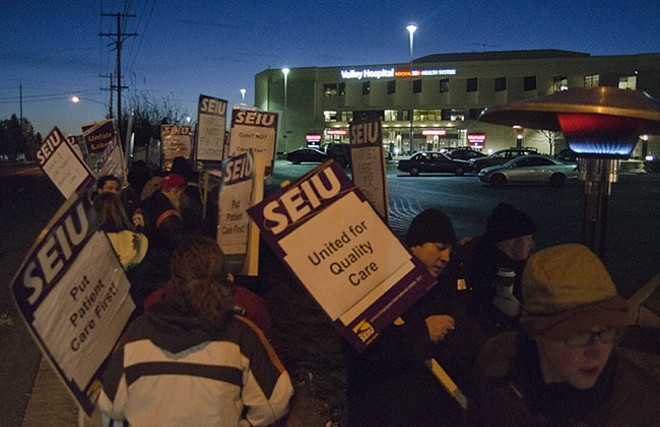 Union hospital employees strike outside Valley Hospital at dawn on Dec. 4. - JACOB JONES