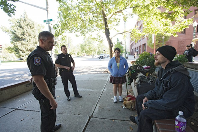 Spokane Police officers on a downtown emphasis patrol last summer. - YOUNG KWAK PHOTO