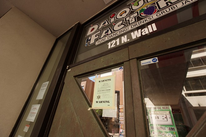 An eviction notice is posted on the front door of the Daiquiri Factory. - YOUNG KWAK PHOTO
