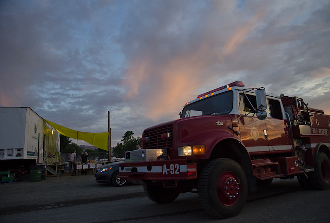 A wildfire engine pulls into the temporary fire camp at the Omak Stampede fairgrounds last week. - JACOB JONES