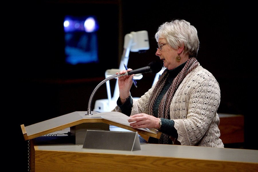 Ann Murphy, president of the local chapter of the League of Women Voters, speaks in opposition to the contract approved by the city council. - YOUNG KWAK PHOTO