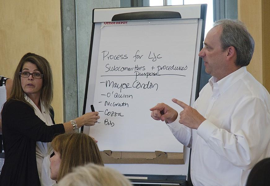 Jacqueline van Wormer, left, and Todd Mielke break down the new subcommittees. - JACOB JONES