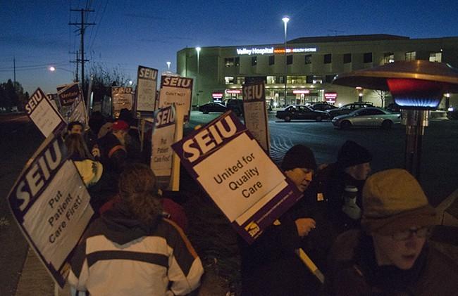 Union hospital employees strike outside Valley Hospital at dawn on Dec. 4. - JACOB JONES
