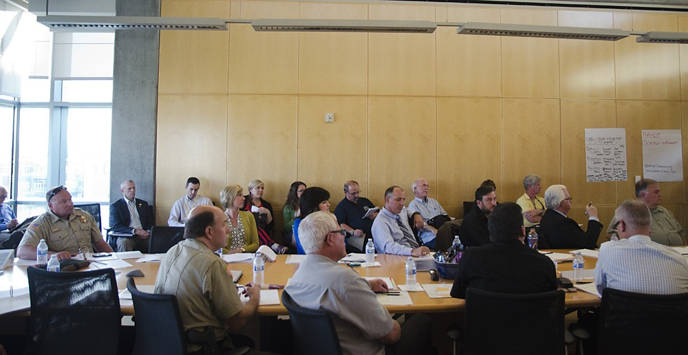 Local law enforcement and justice officials gather Thursday for the first meeting of the renewed council. - JACOB JONES
