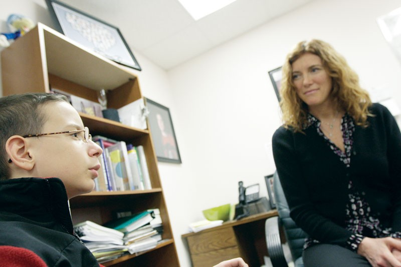 Northwest Autism Center Executive Director Dawn Sidell with 12-year-old J.J. Clardy, who was diagnosed with Aspergers — a form of autism — four years ago. - YOUNG KWAK