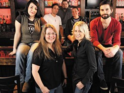 nYne's staff, with owners Kitty Kane and Marci McLaughlin, in the front row.