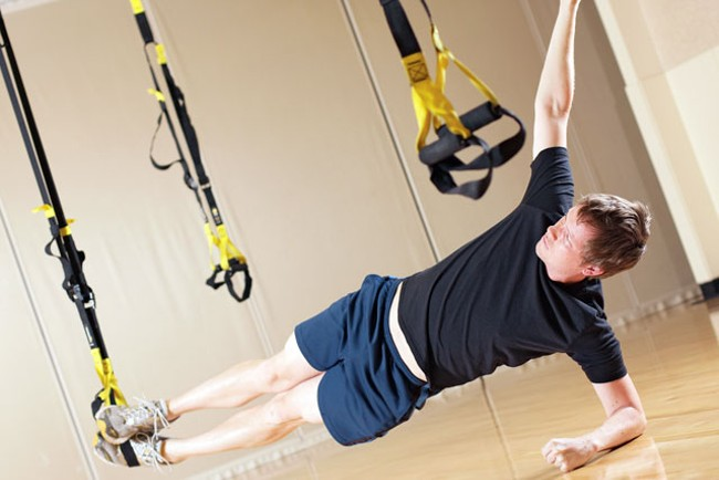 Once you sort out which straps go where, the TRX workout can do the job. - YOUNG KWAK