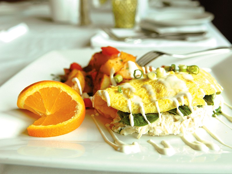 One of Clover\'s specialty brunch items: a crab and artichoke omelet with rosemary breakfast potatoes. - ELLA HERHILAN